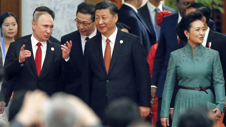 China pledges $124 billion for new Silk Road as champion of globalization